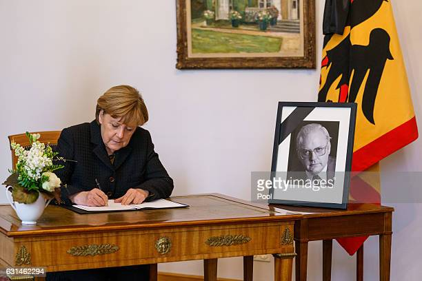 German Chancellor Angela Merkel writes an entry in the book of condolence for the family of Former German President Roman Herzog at Bellevue Palace...
