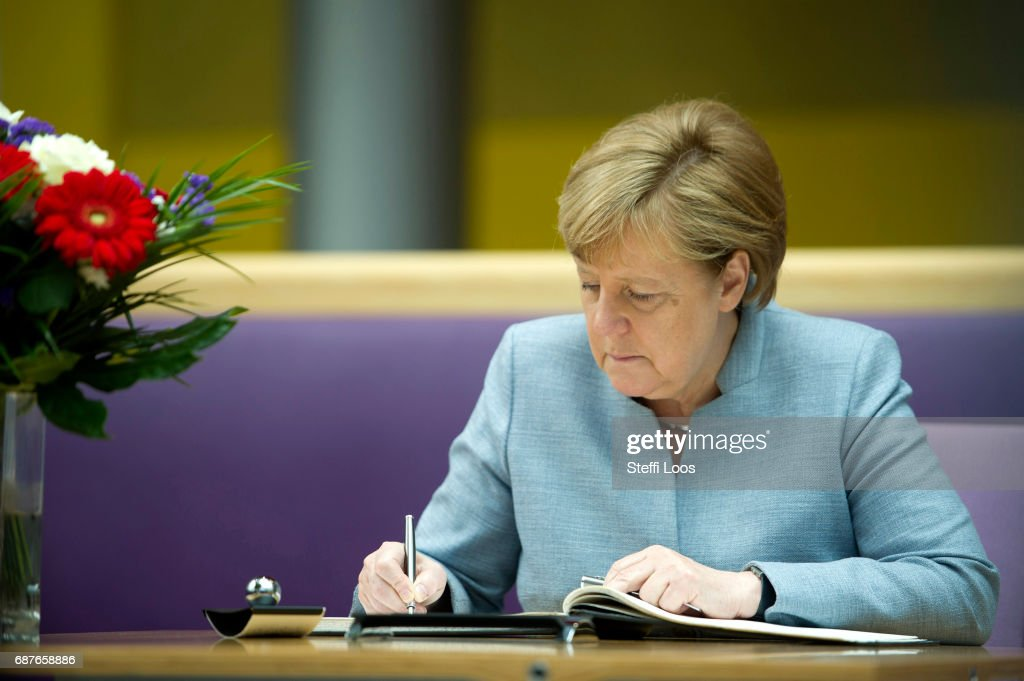 German Chancellor Angela Merkel writes in a book of condolence at the British embassy on May 24, 2017 in Berlin, Germany. An explosion occurred at Manchester Arena as concert goers were leaving the venue after Ariana Grande had performed. Greater Manchester Police are treating the explosion as a terrorist attack and have confirmed 22 fatalities and 59 injured.