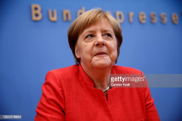 German Chancellor Angela Merkel leaves after she was giving a press conference on July 20 2018 in Berlin Germany Merkel recently returned from...