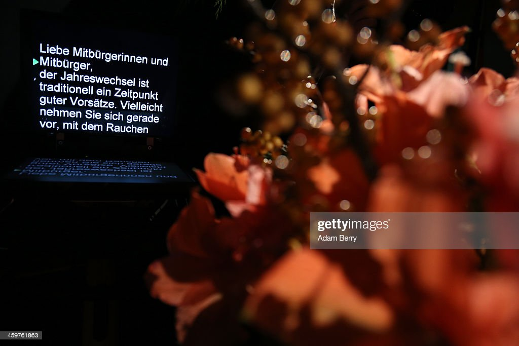 German Chancellor Angela Merkel's New Year's television address to the nation is seen on a teleprompter at the federal chancellery (Bundeskanzleramt) on December 30, 2013 in Berlin, Germany.