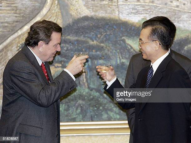 German Chancellor Gerhard Schroeder and Chinese Premier Wen Jiabao toast after a signing ceremony of various trade agreements at the Great Hall of...