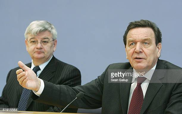 German Chancellor Gerhard Schroeder and German Foreign Minister Joschka Fischer speak at a news conference on January 5, 2005 in Berlin, Germany,...