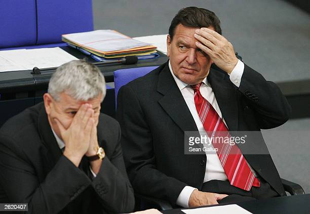 German Chancellor Gerhard Schroeder and German Foreign Minister Joschka Fischer display signs of anxiety during votes at the German parliament...