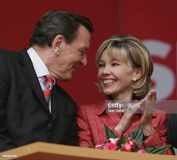 German Chancellor Gerhard Schroeder and his wife Doris SchroederKoepf attend his party's official election campaign launching rally August 13 2005 in...