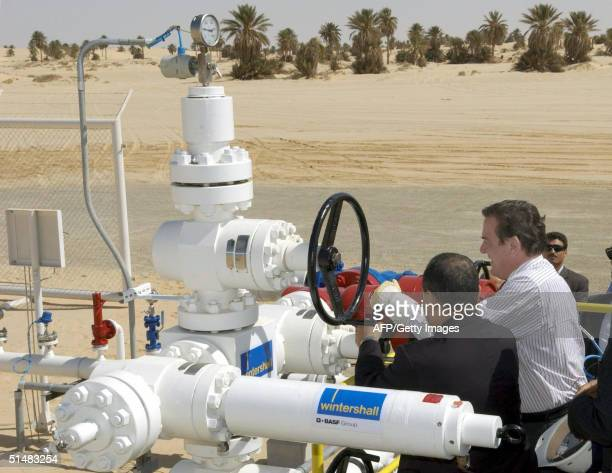 German Chancellor Gerhard Schroeder and Libyan Prime Minister Shukri Mohammed Ghanem open an oil drilling well operated by German company Wintershall...