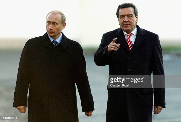 German Chancellor Gerhard Schroeder and Russian President Vladimir Putin take a walk after the press conference at Castle Gottorf on December 21,...