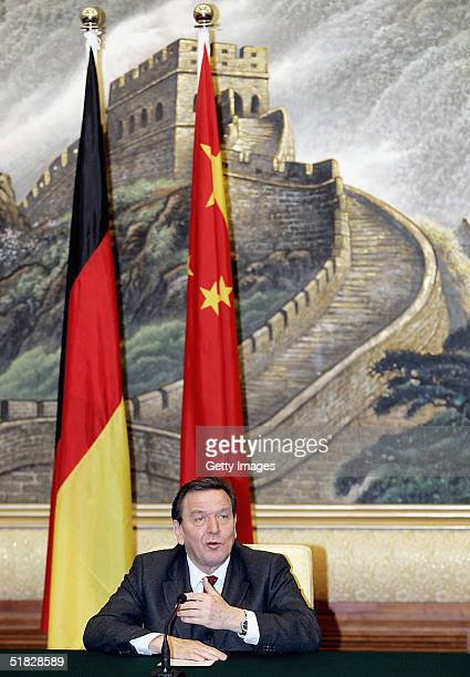 German Chancellor Gerhard Schroeder answers a question during a joint press conference at the Great Hall of the People in Beijing on December 6 2004...