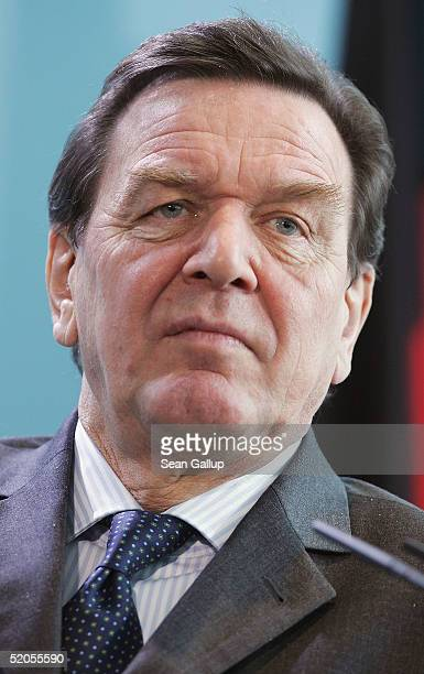 German Chancellor Gerhard Schroeder attends a news conference with Chilean President Ricardo Lagos Escobar at the Chancellery on January 24 2005 in...