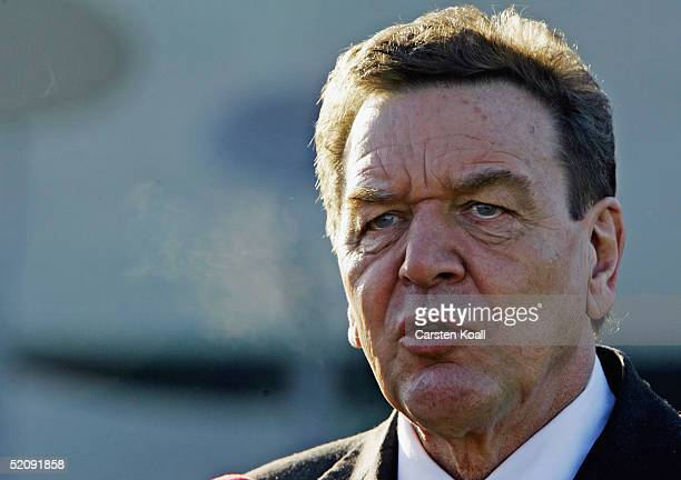 German Chancellor Gerhard Schroeder is seen as a banner carrying the Albert Einstein quote 'the state is for people and not people for the state' is...