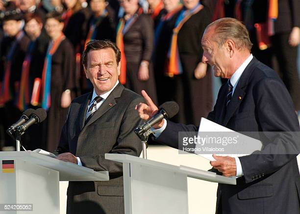 German Chancellor Gerhard Schroeder listens to French President Jacques Chirac's speech during the FrancoGerman ceremony held at the Peace Memorial...