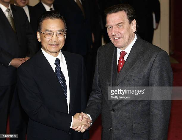 German Chancellor Gerhard Schroeder shakes hands with Chinese Premier Wen Jiabao prior to a meeting at the Great Hall of the People in Beijing on...
