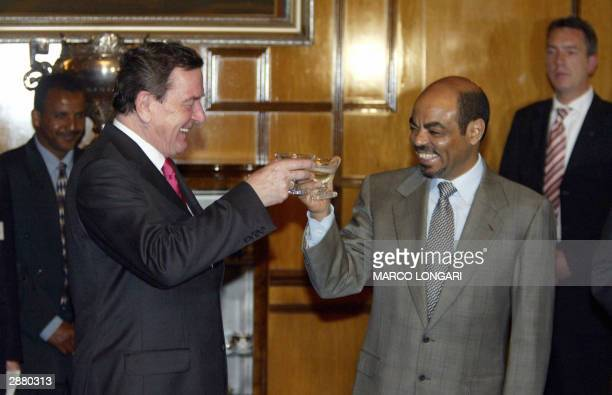 German Chancellor Gerhard Schroeder shares a toast with Ethiopian Prime Minister Meles Zenawi after signing an investment treaty at the Presidential...