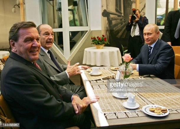 German Chancellor Gerhard Schroeder talks to Russian President Vladimir Putin and French President Jacques Chirac during their meeting on 03 July...