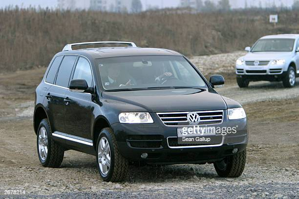 German Chancellor Gerhard Schroeder test drives a Volkswagen Touareg sport utility vehicle October 29, 2003 at the VW factory just outside...