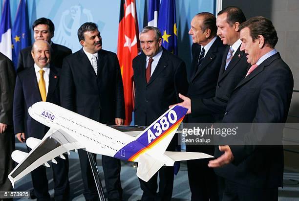 German Chancellor Gerhard Schroeder , Turkish Prime Minister Tayyip Erdogan , French President Jacques Chirac and French Prime Minister Jean-Pierre...