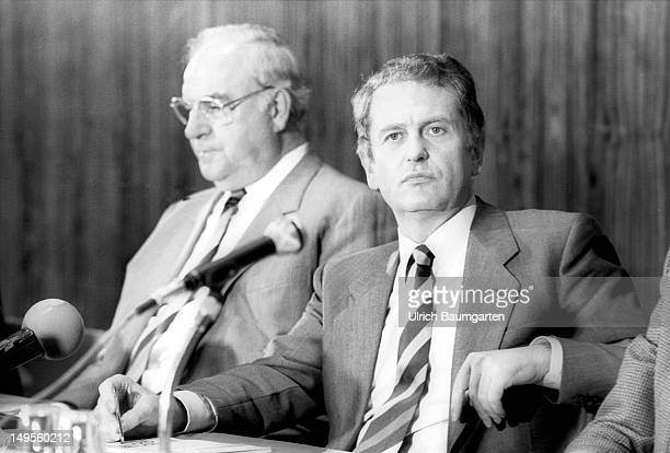 German Chancellor Helmut Kohl and Prime Minister of SchleswigHolstein Uwe Barschel speak during a press conference in the KonradAdenauerHaus on...