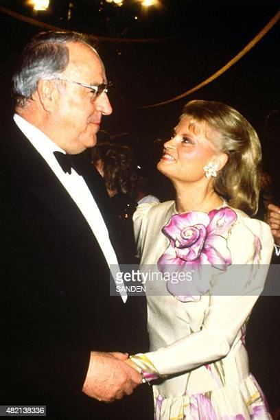 German Chancellor Helmut Kohl dances with his wife Hannelore during a ball in Bonn 14 November 1988