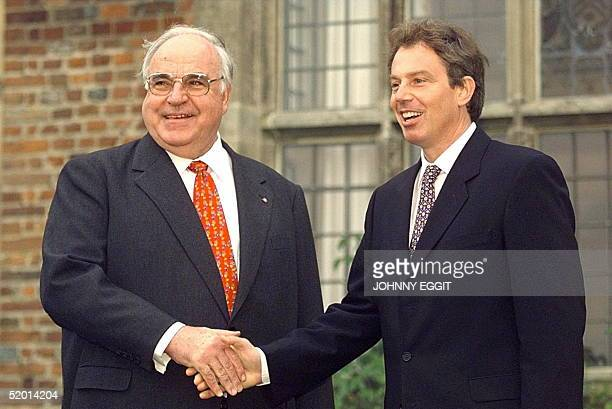 German Chancellor Helmut Kohl is greeted by British Prime Minister Tony Blair as he arrives 20 October at the Prime Minister's official country...