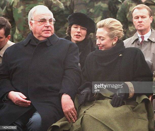 German chancellor Helmut Kohl touches the coat of Hillary Clinton during the speech of US president Bill Clinton to US soldiers at the Baumholder...