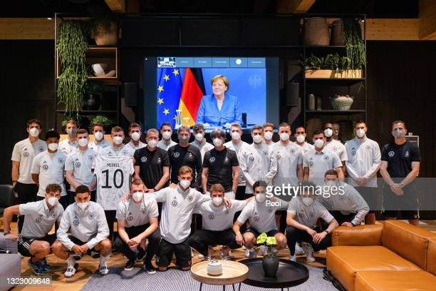 German Chancellor of Germany Angela Merkel addresses the German National Team from a video screen and sends best wishes ahead of the start of the...