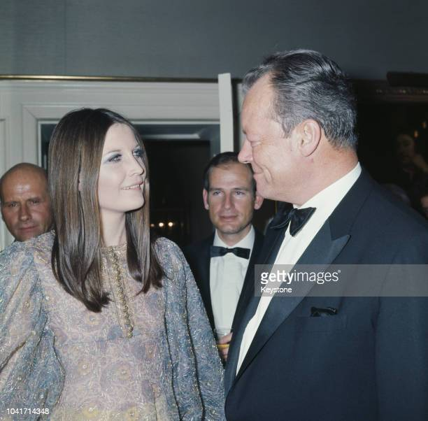 German Chancellor Willy Brandt talks to English singer Sandie Shaw during a reception in Brandt's honour at 10 Downing Street in London 1970
