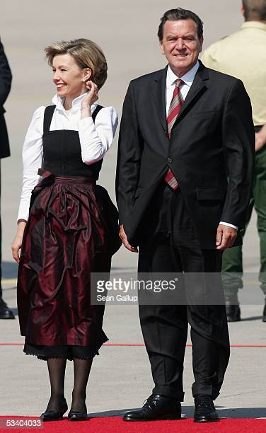 German Chancelor Gerhard Schroeder and his wife Doris SchroederKoepf wait for the arrival of Pope Benedict XVI at Koeln Bonn airport August 18 2005...
