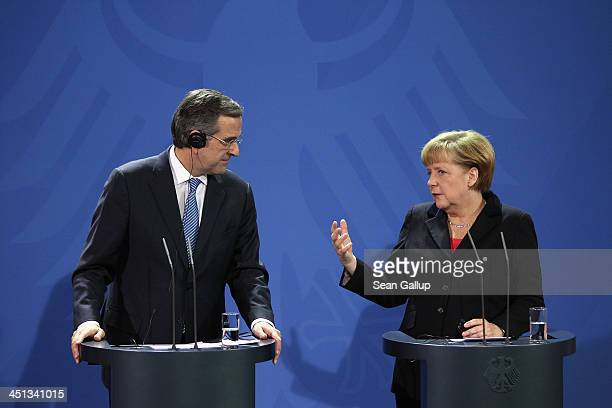 German Chanellor Angela Merkel and Greek Prime Minister Antonis Samaras speak to the media following talks at Chancellery on November 22 2013 in...