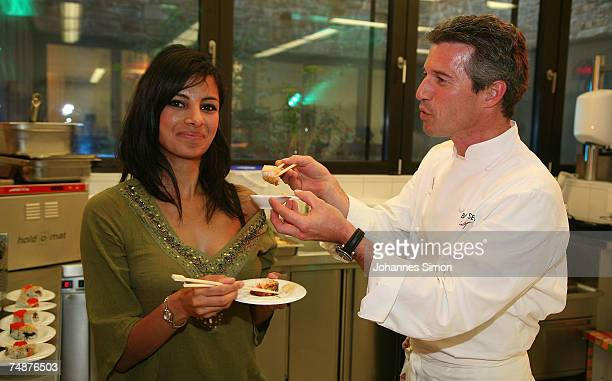 German chef Markus Bischoff from the restaurant 'Bischoff am See' at Tegernsee and TVhostess Collien Fernandes taste sushi food during the top chefs...