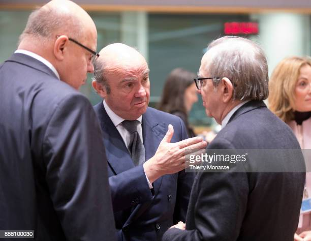 German Chief of Staff and acting finance minister Peter Altmaier and the Italian Minister Economy Finance Pier Carlo Padoan are listening to the...