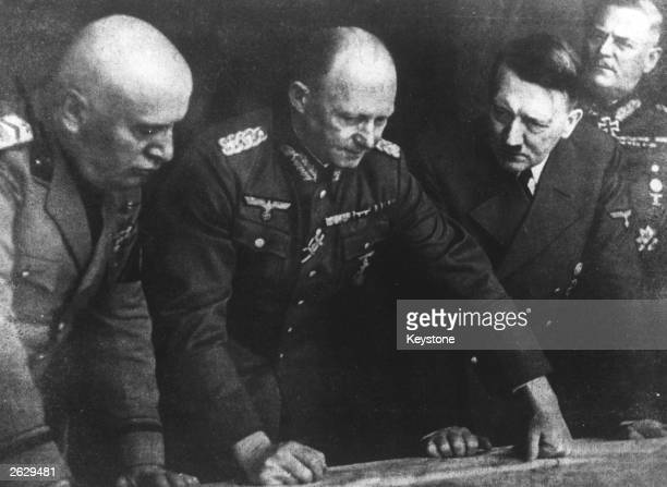 German Chief of Staff General Alfred Jodl with Adolf Hitler Benito Mussolini and General Keitel planning dispositions Original Publication People...