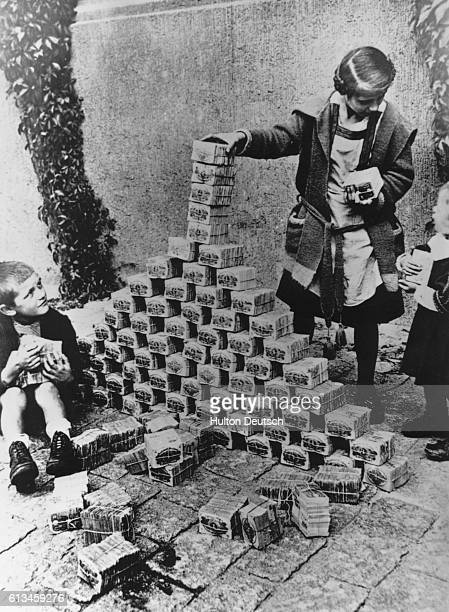 German children in 1923 playing with money in the streets Under the Weimar Republic after WWI inflation was such that $1 US was worth 42 million DM...