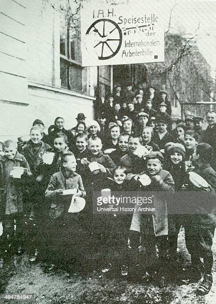 German children receive soup at a communal kitchen during the poverty years of the depression in Weimar Germany c1923