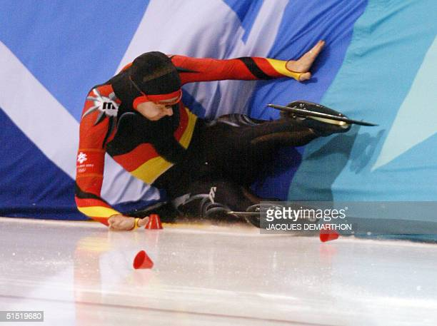 German Christian Breuer crushes into the bareer in the men's 1500m speed skating race at the Utah Olympic Oval 19 February 2002 during the XIXth...
