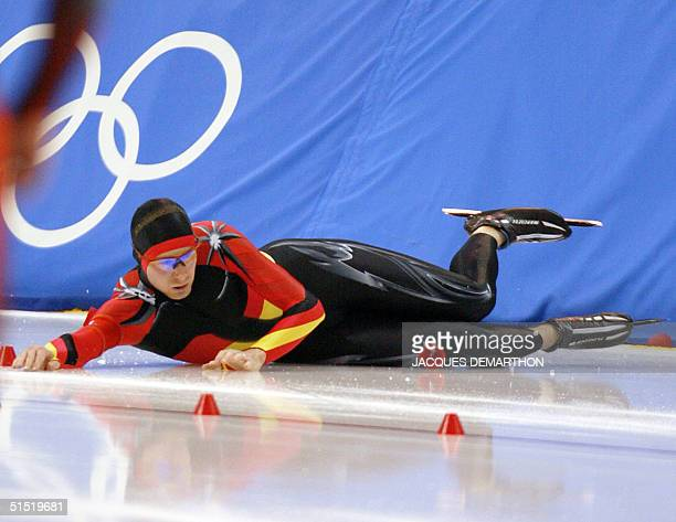 German Christian Breuer lies on the ice after falling in the men's 1500m speed skating race at the Utah Olympic Oval 19 February 2002 during the...