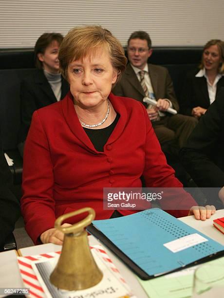 German Christian Democrat and future German Chancellor Angela Merkel attends a meeting of the CDU Bundestag faction where party member Volker Kauder...