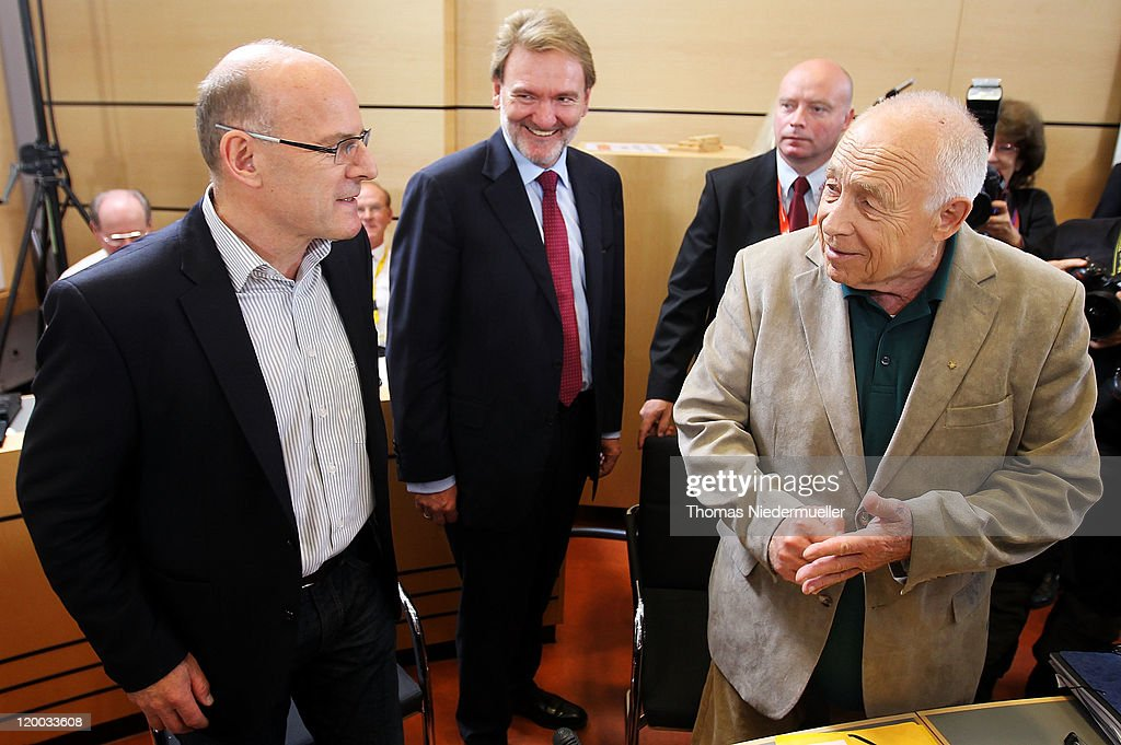 German Christian Democrat (CDU) Heiner Geissler (R), who has been commissioned to mediate between the conflicting parties in the Stuttgart 21 railway station project talks to Volker Kefer (C), manager of Deutsche Bahn AG and Winfried Hermann (L), minister of transport of Baden-Wuerttemberg on July 29, 2011 in Stuttgart, Germany. Geissler presents the results of the so called stress test, a computer based simulation of the capacity of the new railwaystation. The Stuttgart 21 project will replace the city's current terminal train station with a more efficient underground station and allow the creation of a new residential and office district in the city center. Thousands of irate activists oppose the project, citing the high cost, environmental impact and uncertain technical aspects.