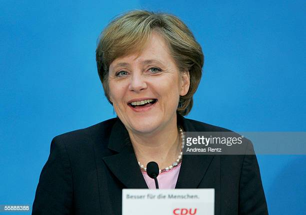 German Christian Democrat leader Angela Merkel announces at a news conference at CDU headquarters that the CDU will represent the German Chancellor...
