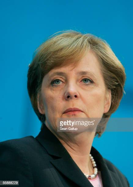 German Christian Democrat leader Angela Merkel speaks after announcing that the CDU and rival the Social Democrats have agreed on an outline for a...