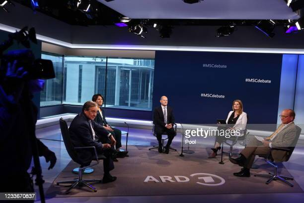 German Christian Democratic Union leader Armin Laschet, Green party co-leader Annalena Baerbock and German Finance Minister Olaf Scholz of the Social...