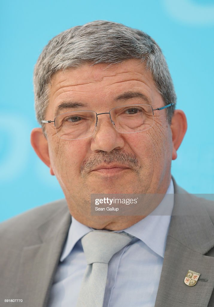 German Christian Democrats (CDU) chairman in Mecklenburg-Western Pomerania Lorenz Caffier sepaks during an election campaign event at the Zinzow farming cooperative (Agrargenossenschaft Zinzow) on August 18, 2016 in Boldekow, Germany. Mecklenburg-Western Pomerania, one of Germany's 16 federal states (Bundeslaender), is scheduled to hold elections on September 4. So far the CDU is close in the polls against the German Social Democrats (SPD). The populist Alternative fuer Deutschland (AfD), a political newcomer that is attracting right-wing voters, has double-digit support and will certainly gain seats.