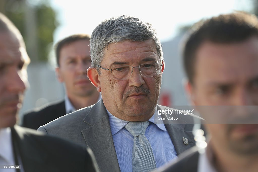 German Christian Democrats (CDU) chairman in Mecklenburg-Western Pomerania Lorenz Caffier attends an election campaign event at the Zinzow farming cooperative (Agrargenossenschaft Zinzow) on August 18, 2016 in Boldekow, Germany. Mecklenburg-Western Pomerania, one of Germany's 16 federal states (Bundeslaender), is scheduled to hold elections on September 4. So far the CDU is close in the polls against the German Social Democrats (SPD). The populist Alternative fuer Deutschland (AfD), a political newcomer that is attracting right-wing voters, has double-digit support and will certainly gain seats.