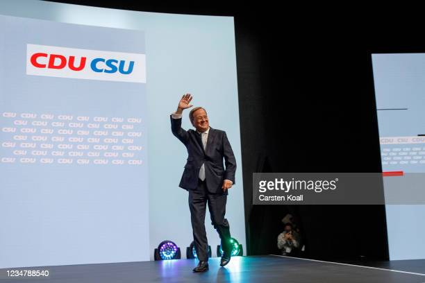 German Christian Democrats chancellor candidate Armin Laschet greets supporters at a virtual election campaign rally at Tempodrom on August 21, 2021...