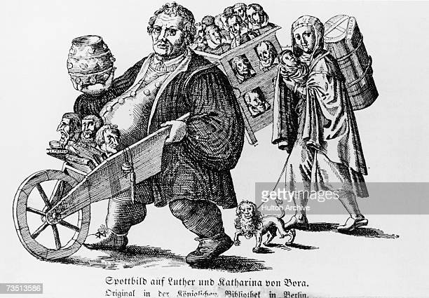 German church reformer Martin Luther with his wife Katharina von Bora and a wheelbarrow full of books circa 1530