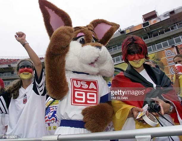 German citizens Katrin Seemann and Kerstin Schmidt meet Women's World Cup mascot Nutmeg at Jack Kent Cooke Stadium 01 July 1999 in Landover Maryland...