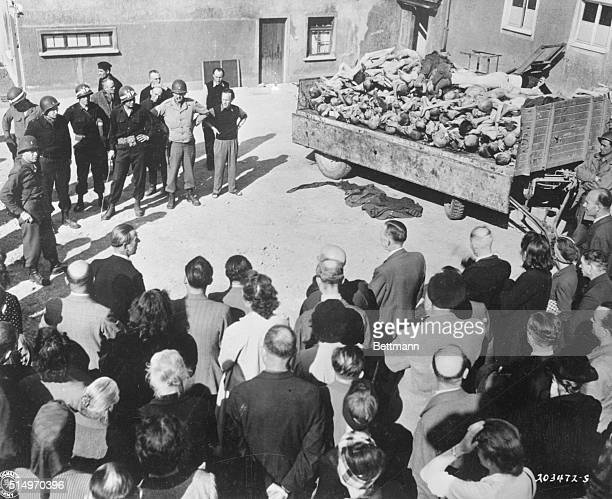 German civilians of Weimar witness a truckload of prisoner dead at Camp Buchenwald here a Nazi concentration camp Civilians were forced by US Third...