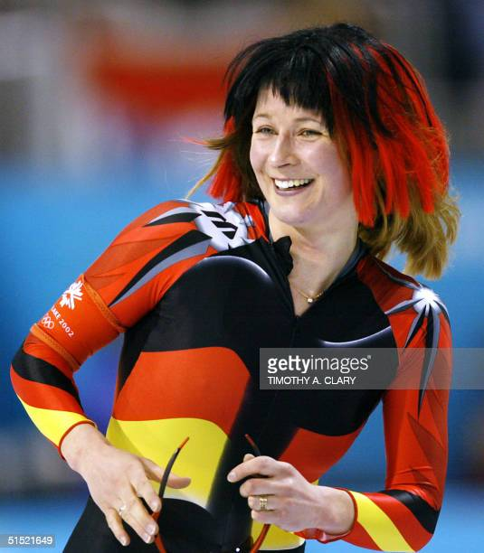 German Claudia Pechstein skates wearing a wig with the colors of Germany after setting a new World record with 64691 in the women's 5000 m speed...