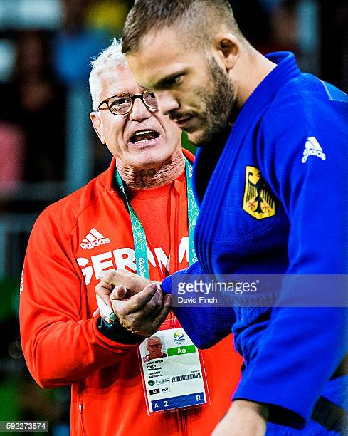 German coach and former world champion Detlef Ultsch encourages KarlRichard Frey as he steps on the mat in the u100kg repechage contest that Frey won...