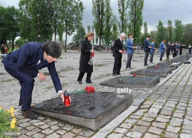 German coach Joachim Loew and Dr Charlotte Knobloch President of the Jewish community of Munich and Upper Bavaria place candles as they pay their...