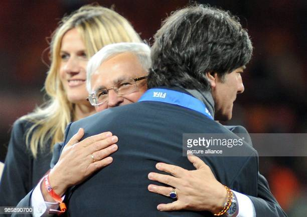 German coach Joachim Loew embraces DFB President Theo Zwanziger after the 2010 FIFA World Cup third place match between Uruguay and Germany at the...