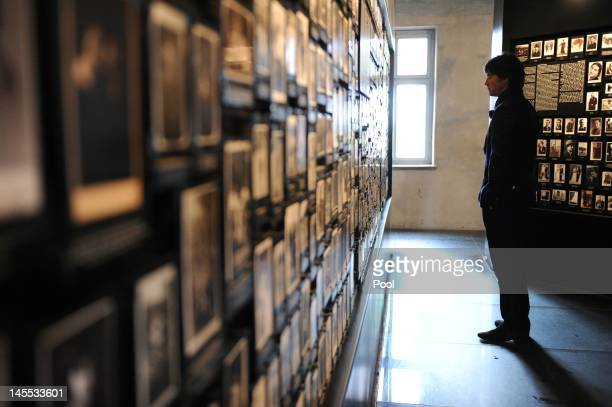 German coach Joachim Loew looks at personal photos that belonged to incoming prisoners in the socalled Central Sauna Building during a visit by a...